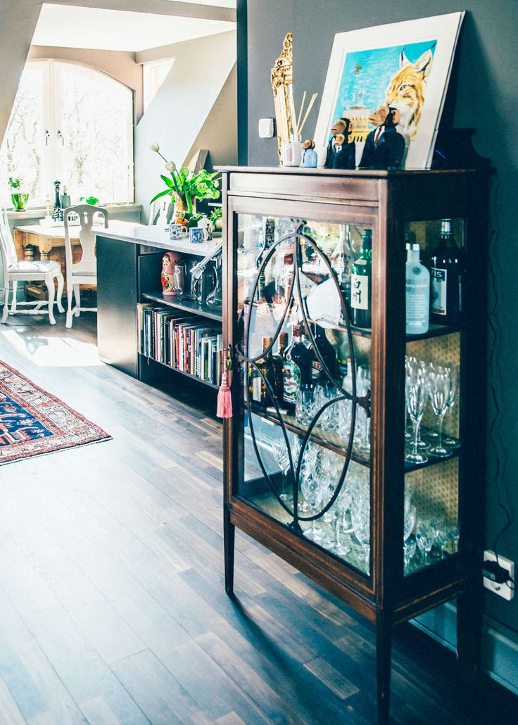 Dark wood cabinet with glassware