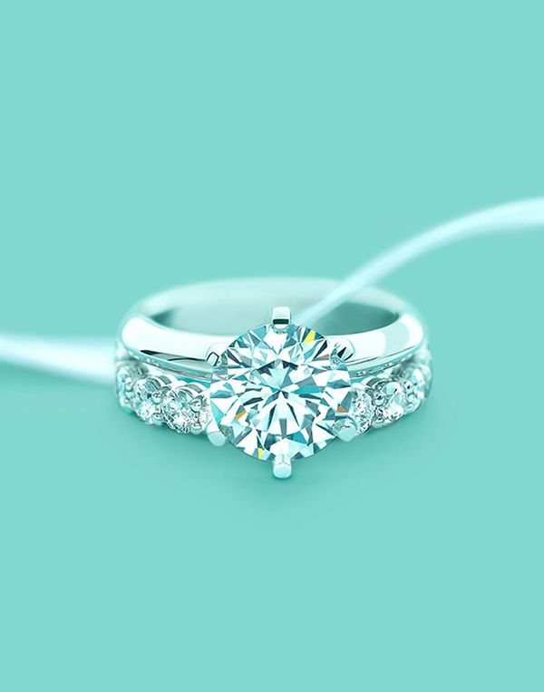 Unique Tiffany's round shaped #wedding #engagement ring with a shared-setting diamond band