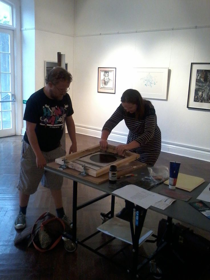 Artist Martin Fahy showing visitors the screen print technique!