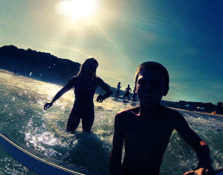 Mandi and Matt in the sea at Haga Haga