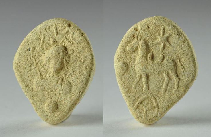 Palmyra clay token, 2nd-3rd century A.D.  Palmyra clay token representing Helios or Al shams God with Aramaic inscription at one side, with horse standing left, above star and monogram below on the other side, 2.5 cm long and 0.5 cm high. Private collection For more info about Palmyra token please visit http://www.archaeology.wiki/blog/2016/06/13/tokens-tesserae-palmyra/