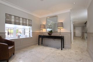 Dado walls in entry. Paneling painted in Elephants Breath with Skimming Stone above, paint available from Farrow Ball.