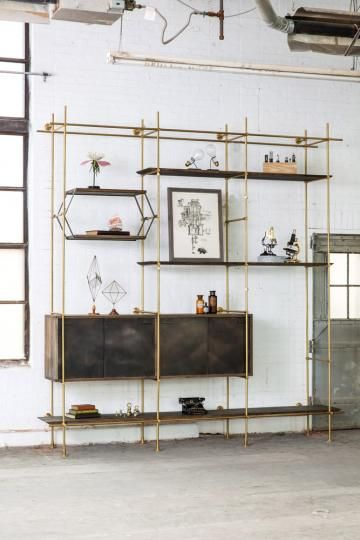 brass and wood shelving.