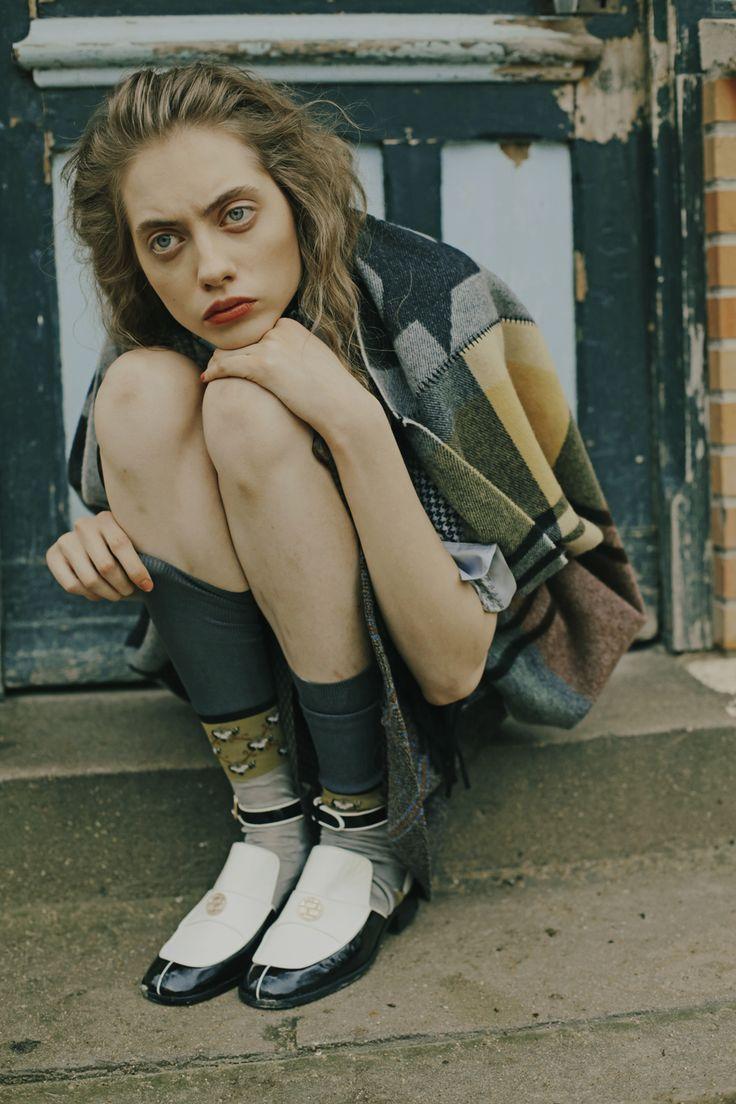 Patchwork effect   Greys, mustard and white   Strange   Sitting   Odette Pavlova