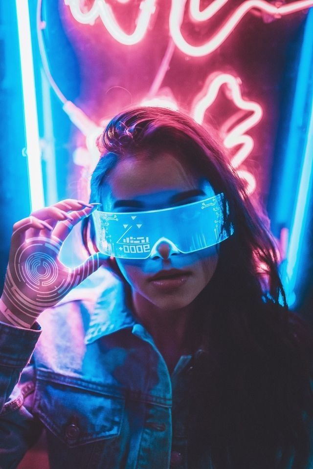 Cyberpunk style night portrait photography woman in glasses android robo  Cyberpunk  City
