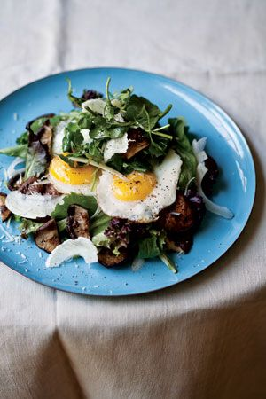 Breakfast salad with fried egg, grilled shiitake mushroom, and fennel.