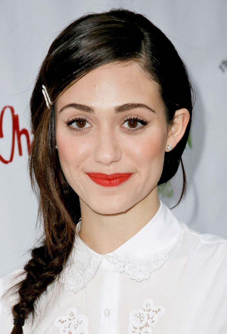 Braids can be tough to rock when you're growing out layered bangs! A loose side-braid like Emmy Rossum's works best with longer fringe, because pieces falling out look totally natural. Use bobby pins to keep your bangs out of your eyes, letting some longer layers in front fall out and frame your face.   - Seventeen.com
