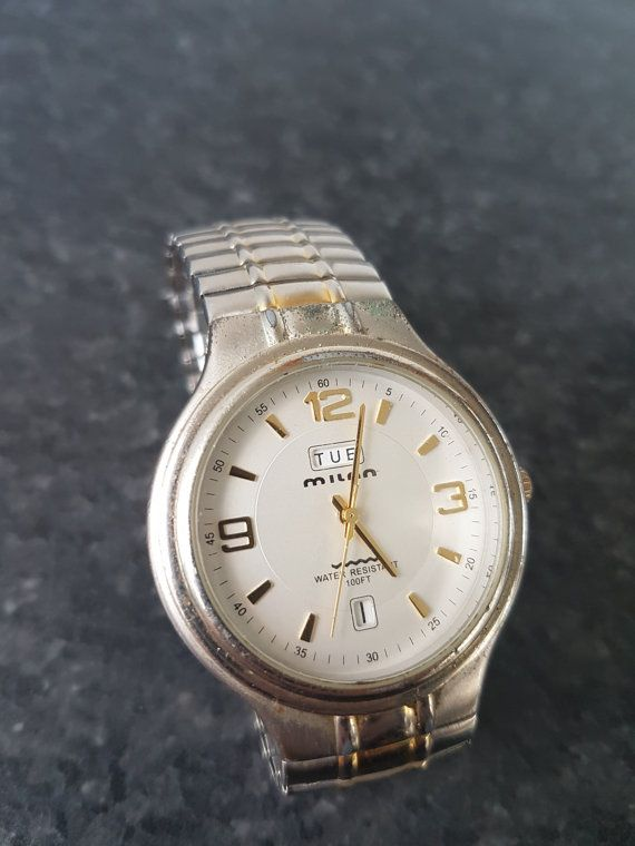 Golden Milan Watch, Great Condition, Fully Working 1980s-1990s  Quartz Movement  Everything is working.  Looks really classy!    Swatch Collection : https://www.etsy.com/shop/InstaAntiques?ref=l2-shopheader-name&section_id=20319988    All watches exposed are part of a big collection. I will keep on adding until I reach 1000 watches on Etsy! My father and grandfather have collected watches for almost 80 years! This means there will be watches ranging from 100+...