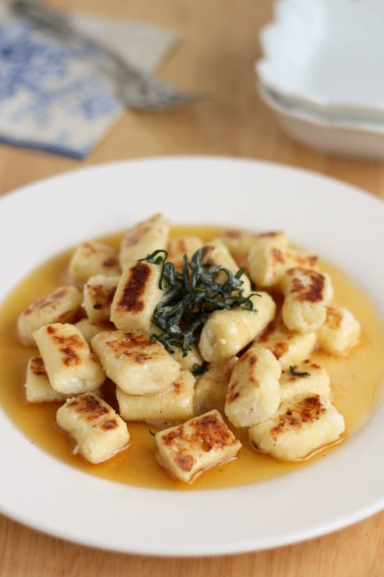 Ricotta Gnocchi - A traditional Florentine pasta, Ricotta Gnocchi is the lighter, hipper cousin to northern Italy's potato gnocchi. This gnocchi cooks up as soft, mild-flavored dumplings. They make a great base for any sauce. Here they were also browned, so they would be crisp on the outside; then arranged on the plate w/ simple sage & brown butter sauce