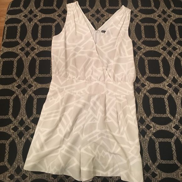 Shop Women's A/X Armani Exchange Gray White size 10 Jumpsuits & Rompers at a discounted price at Poshmark. Description: Like new Armani exchange shorts romper with v-neck tank top. Light grey and white design. Zipper back. Sold by jaclynnj91. Fast delivery, full service customer support.