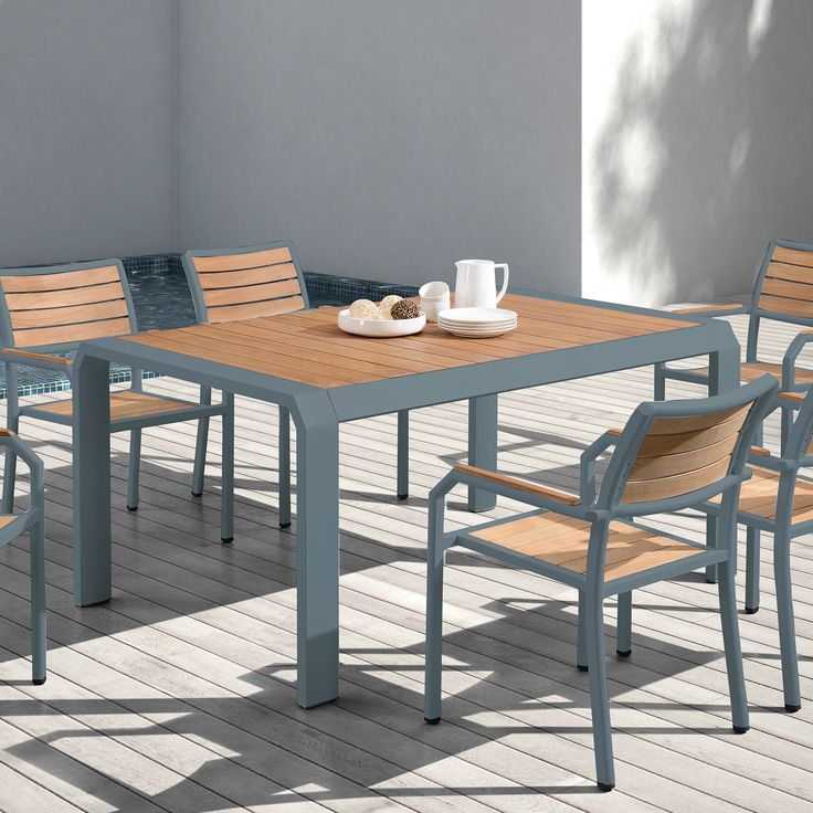 Armen Living Minsk Outdoor Patio Dining Table in Gray Powder Coated Finish with Teak Wood. The Armen Living Minsk contemporary outdoor dining table is an ideal addition to the modern household patio. This beautiful table features a teak wood top that adds charm to the study aluminum structure. This exquisite table is guaranteed to exude style while maintaining durability. The Minsk outdoor table is available in gray powder coated finish and ideal when coupled with the Minsk outdoor dining…