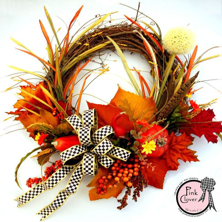 Surround your front door with the sense of fall and the coming of the holidays. Pumpkins and gourds nestled among fallen orange and gold leaves, fall colored grasses intertwined with grapevine and ber