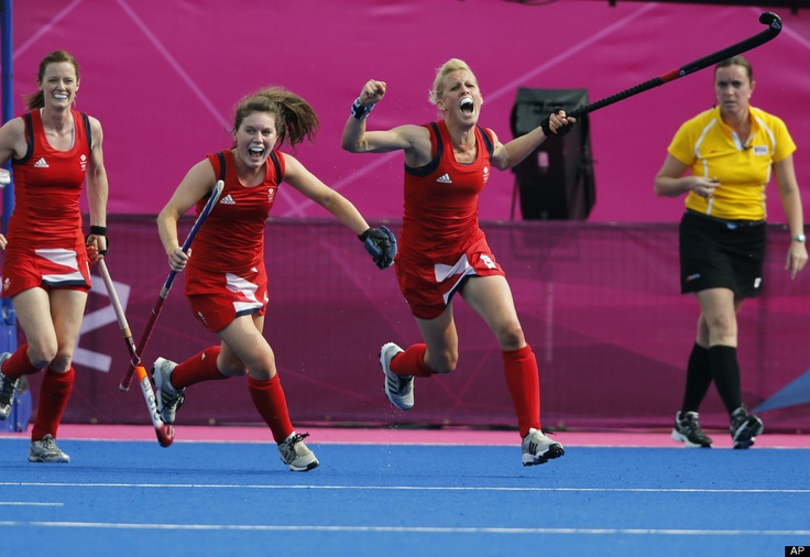 Britain's Alex Danson, right, celebrates after scoring a goal against New Zealand during the women's field hockey bronze medal match at the 2012 Summer Olympics, Friday, Aug. 10, 2012, in London.