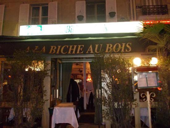 Coq au vin, frites, and poached pears at A  La Biche au Bois in Paris.