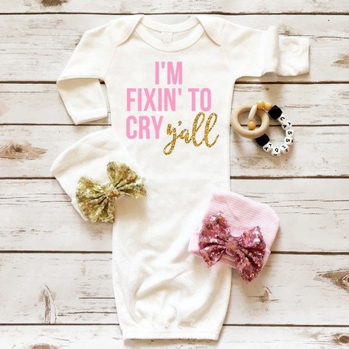 I'm Fixin' To Cry Y'all™ | The perfect gown for your new precious baby girl. An incredibly soft fabric with the glitz and glam of glitter accents! Printed in sparkly gold glitter and soft pink solid p