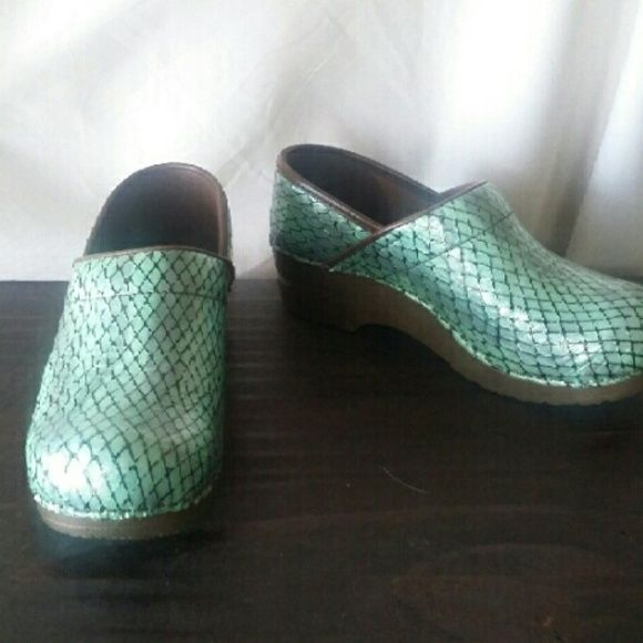 Sanita Professional clogs Nearly new Sanita Professional clogs in a unique seafoam print - you'll look like a beautiful mermaid nurse! But seriously, they are sooo comfortable and supportive, and this brand holds up forever. Similar to Dansko. Sanita Shoes Mules & Clogs