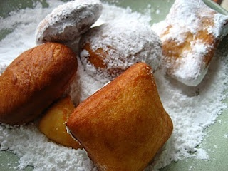 Romanian Gogosi. I'm in search of the perfect beignet recipe. When fried it needs puff up and have that pocket in the middle. Hope this is the one!