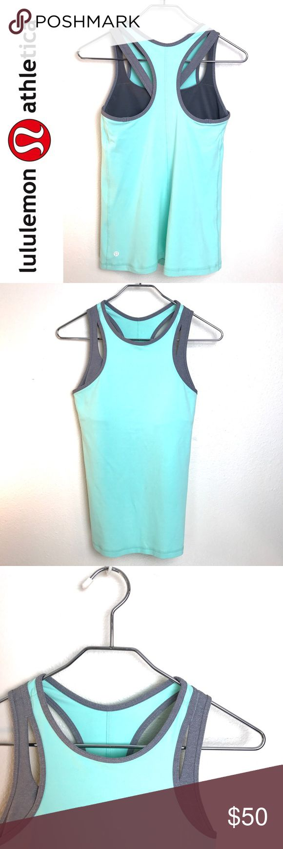 Lululemon Racerback Mint & Gray Athletic Tank Lululemon Racerback Mint Green & Gray Athletic Tank. Built in sports bra. Excellent condition. Size 6 lululemon athletica Tops Tank Tops