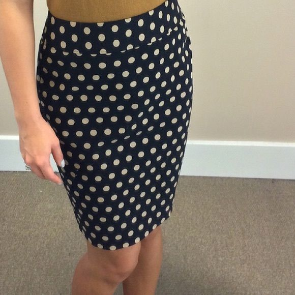 Blue Polka Dot Skirt Great polka dot skirt in navy Blue. The material is heavy weight and super comfortable. The size on the label is 10, which is equivalent to a US size small (2-4). The skirt length is about 23 inches long and the waist is 18 inches. Minor rip in the back near the slit.. Can be easily fixed! Tagged Banana Republic. By Australian brand, Jay Jays. Banana Republic Skirts