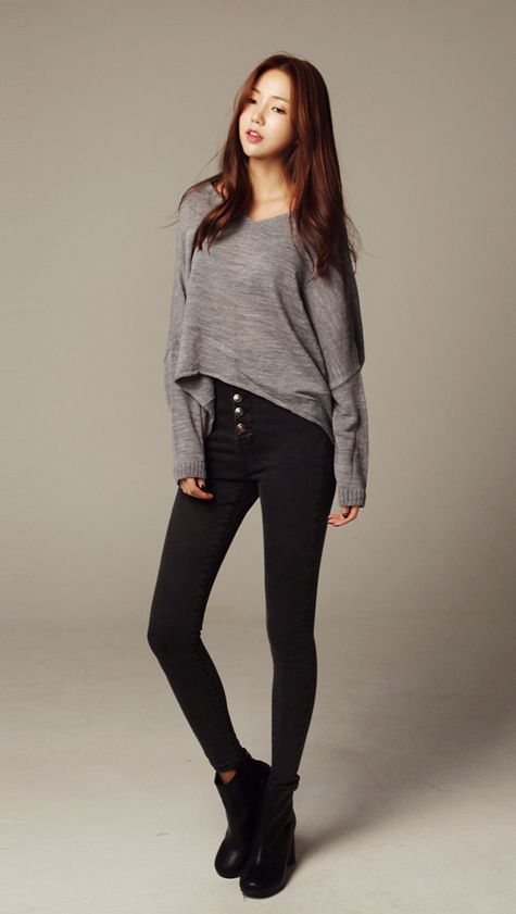 Cute fall outfit with the slightly high-low grey sweater, high-waisted black pants, and black boots.