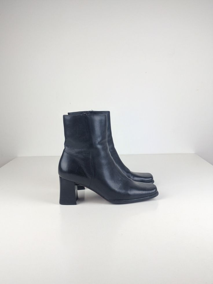 Very chick, black leather square toe and heel, Nine West boots in a size 8. Man made lining. Leather and rubber sole. Excellent condition. Made in Brazil.  For best fit, please compare the following measurements with a similar pair of your own boots:  Outside length: 10 Inside length: 10.25 Width: 3.5 Heel height: 2.75 Ankle diameter: 3.25   Want to see more boots and shoes? Check out my other listings at: https://www.etsy.com/ca/shop/TonAmieVintage?ref=hdr_shop_menu§ion_id=19738228  Have a…