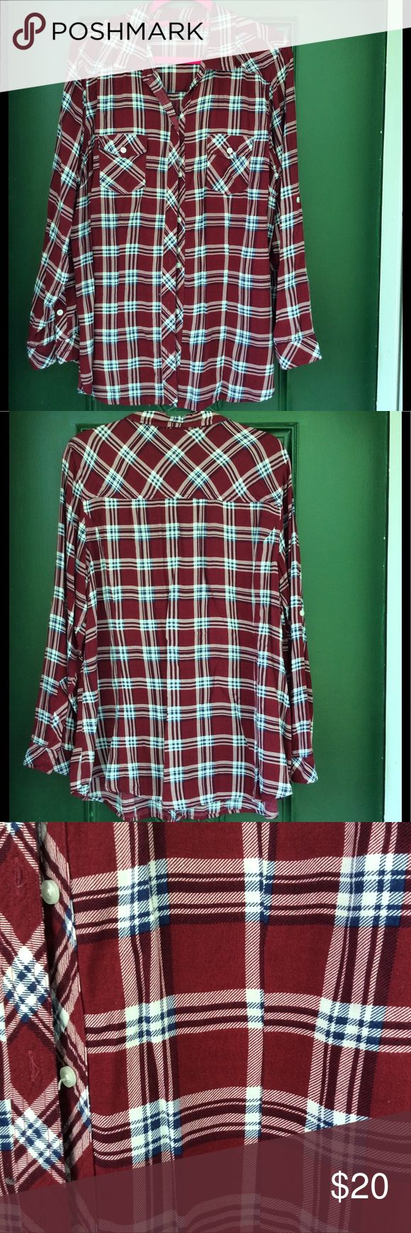 Torrid Deep Red Plaid Shirt This is a light fabric since it is 100% rayon so not heavy like traditional flannel or cotton plaid shirts. Looks great over a white cami. The red is a deep brick red color and there is a dark blue with white striping. This has been gently worn. The sleeves can be pulled up by straps on the outer sides that button up on the outside. No tears no stains. No pets, no smoking and no smoking pets (Sorry I had to go there) torrid Tops Button Down Shirts