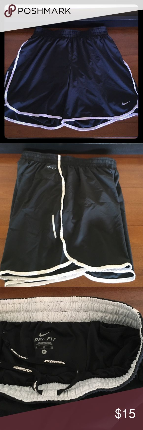 """Nike running shorts, size M Black Nike dri-fit running shorts, size Medium. Love that these are a bit longer (~14"""" from waist to seam). Lined with dri-fit material, and includes 2 small inner pockets for a key, GU, etc. White trim and logo with reflective details. Great shorts, barely worn! Nike Shorts"""