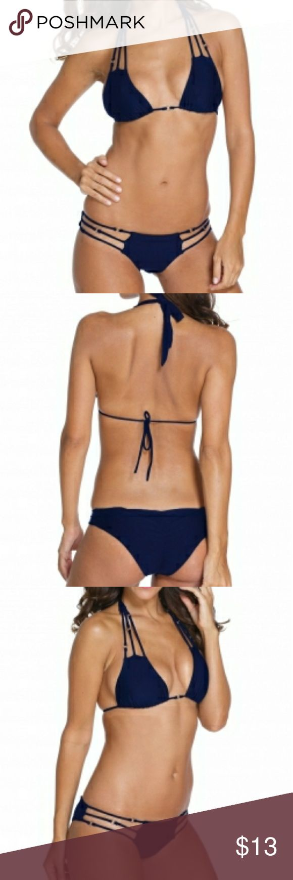 """Navy Stylish silver Ring Detail Strappy Bikini Be blazing hot in this little black triangle top! Not your basic triangle with trio spaghetti, silver ring detail, thick neck ties and our signature """"B"""" cord ends. Sliding design with removable bra paddings but no underwire. Barely there skimpy bottom with silver ring and spaghetti detail. Back shirring and low rise. Swim Bikinis"""