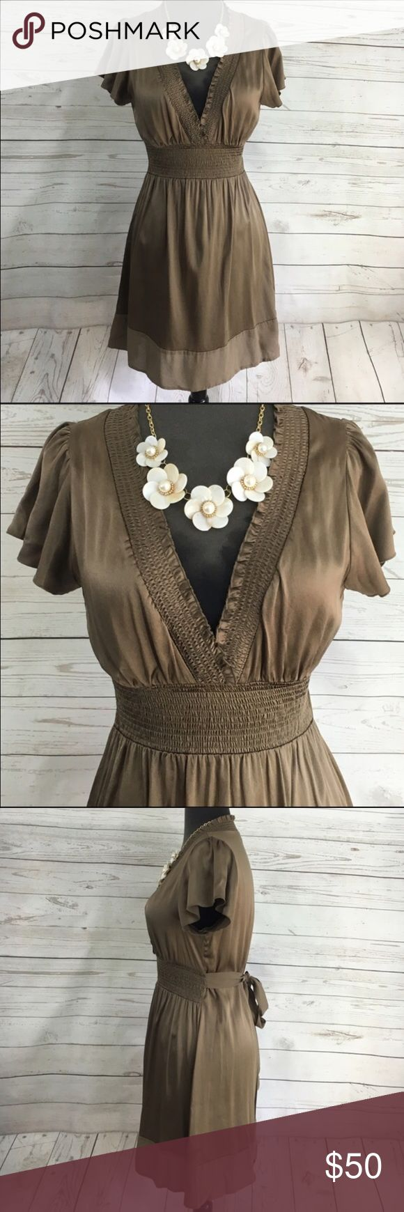 "BCBG Silk Olive Empire Dress Short Sleeve BCBG Maxazria XXS Silk Dress. Beautiful Olive color. Empire waist, V neckline, stretch in the waist. Ties in the back. Short sleeve. Made of 92% silk 8% spandex. Pre loved Good condition. Length 33"" Width 24"" Bust 30"" BCBGMaxAzria Dresses Midi"