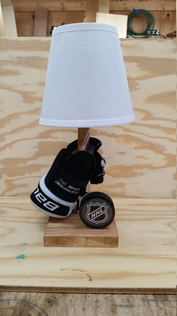 Customizable Hockey Lamp with glove, stick and puck. Any NHL team puck can be used. Any personal puck can also be used if provided by buyer.