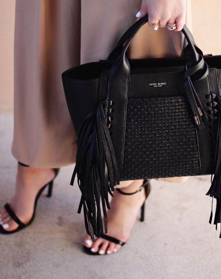 Bring a whole lot of wow to town whenever you carry the Woven Fringe Brunch Tote. Crafted with sensuously pebbled leather with flirtatious fringe detailing and luscious satin lining, this singular designer handbag is for the Bendel Girl who loves to flaunt her fabulosity.