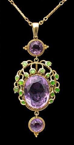 Jessie Marion King for Liberty & Co. Gold, enamel and amethyst pendant, c. 1900. H: 5.5 cm (2.17 in) W: 2.2 cm (0.87 in) British, c.1900 Fitted Case Minor repair to enamel Literature: cf. Liberty Jewellery sketch-book, page 290 Model number: 8603