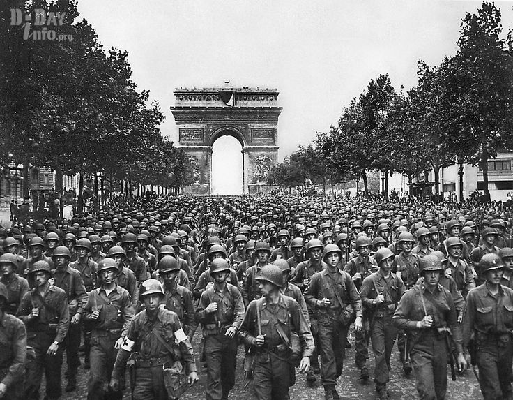 American soldiers from the 28th Infantry Division march on the Champs Elysees, the Arc de Triomphe in the background, on August 29, 1944, Four days after the liberation of Paris.