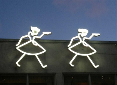 """Neon waitresses"" on the 1930s Lasipalatsi (Glass Palace) building, Helsinki"