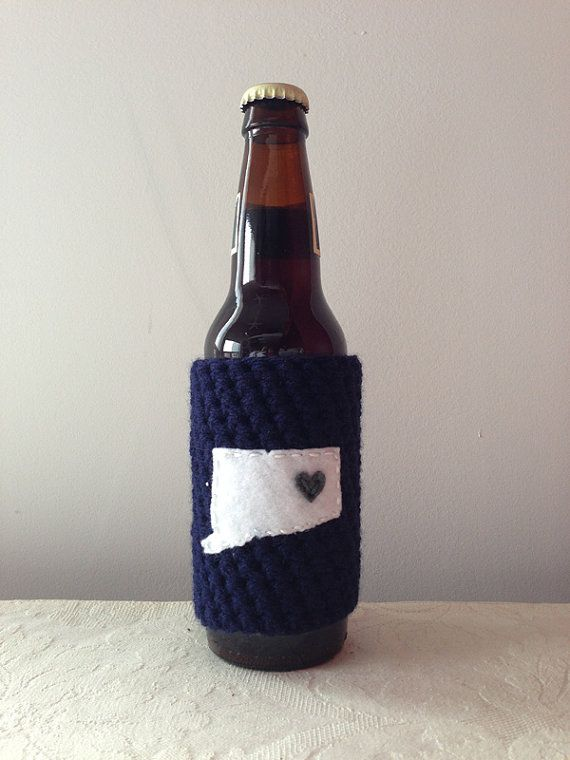 This navy crochet cozy comes with a white felt Connecticut state map applique attached with embroidery thread. Show your love for the University of Connecticut, UConn, Mansfield, Connecticut and college sports by sporting this super cool state map cozy. Each city map cozy comes with gift packaging (view images above for more details) so you can wow your special someone with a Maroozi!  This Maroozi cozy will fit most glass or plastic bottles (12 & 16 oz.), beverage cans, and most disposable…