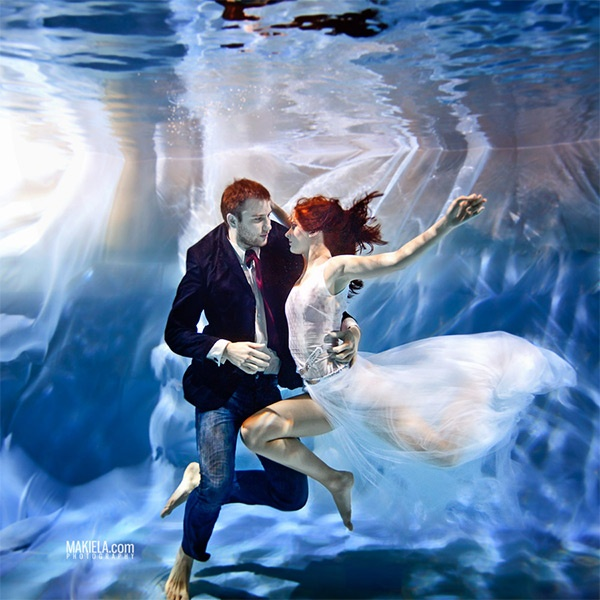 Photograph underwater lovers by rafal makiela on