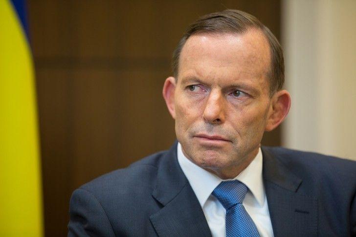 Church Presents Family History to Prime Minister Tony Abbott of Australia.