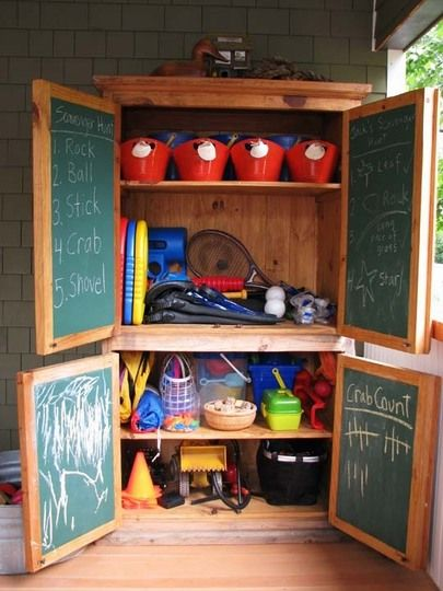 Move a wardrobe outside for attractive toy organization/chalkboard on interior doors
