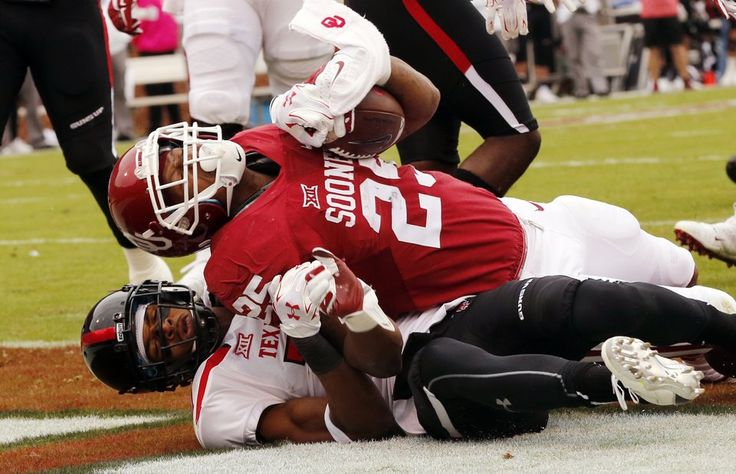 Oklahoma's Joe Mixon (25) scores during a college football game between the University of Oklahoma Sooners (OU) and the Texas Tech Red Raiders at Gaylord Family-Oklahoma Memorial Stadium in Norman, Okla., on Saturday, Oct. 24, 2015. Photo by Steve Sisney, The Oklahoman
