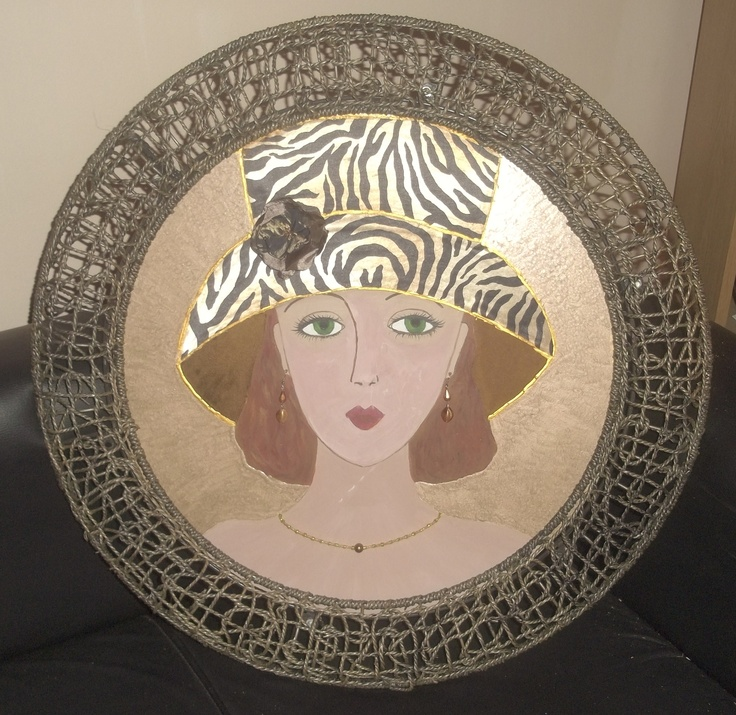 Painting with woven 'bamboo' frame and steel backing.  Diameter: 450 mm  Price: R350 (ZAR)