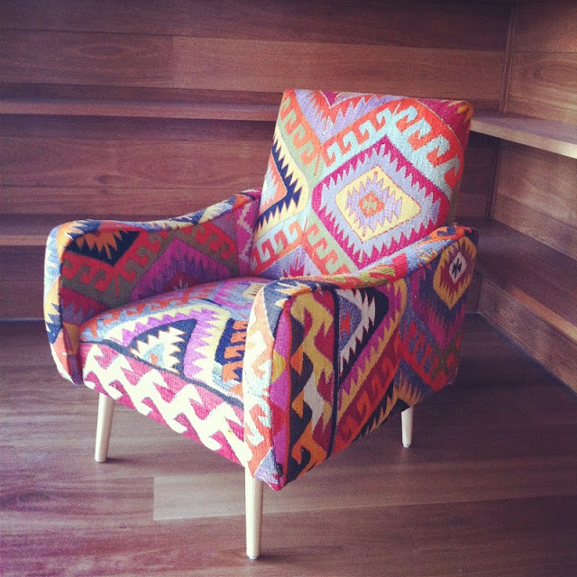 chair upholstered in a kilim rug. Via absolutely beautiful things