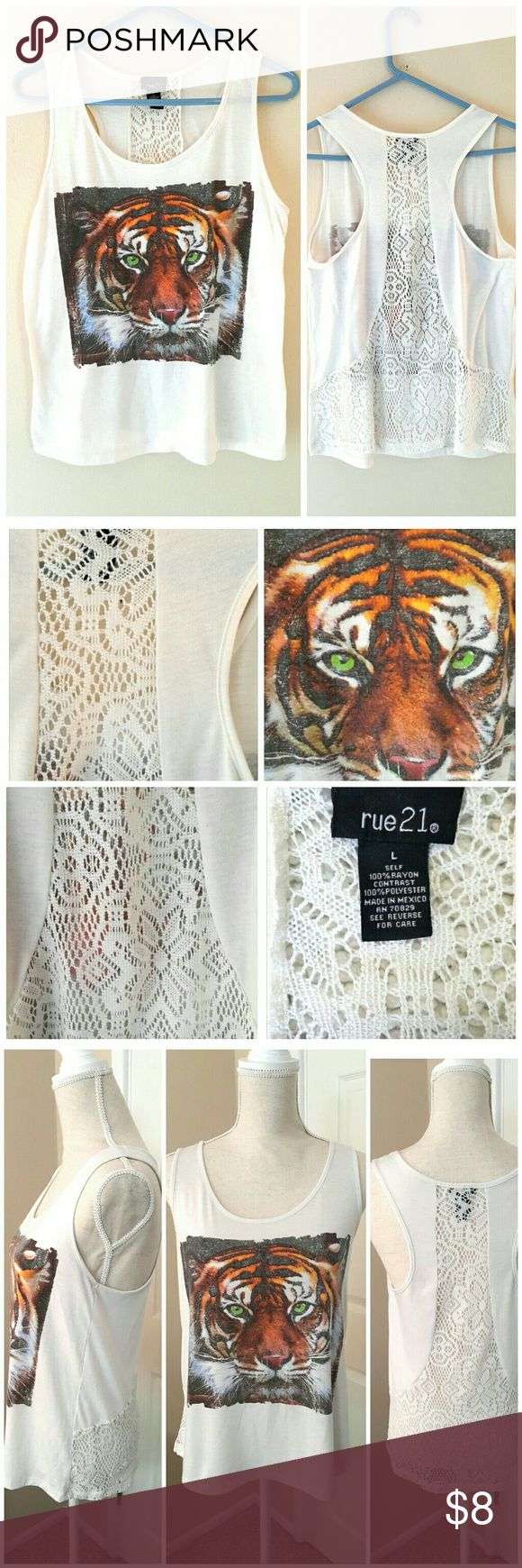 "Rue21 White Lace Tiger Face Print Tank Top Size L White Lace Tiger Face Print Tank Top from Rue21. Size Large. Small sign of wear but overall really great condition - no stains or rips. Made in Mexico.  ℹ Chest 17"", Length 23"" Measured flat Rue21 Tops Tank Tops"