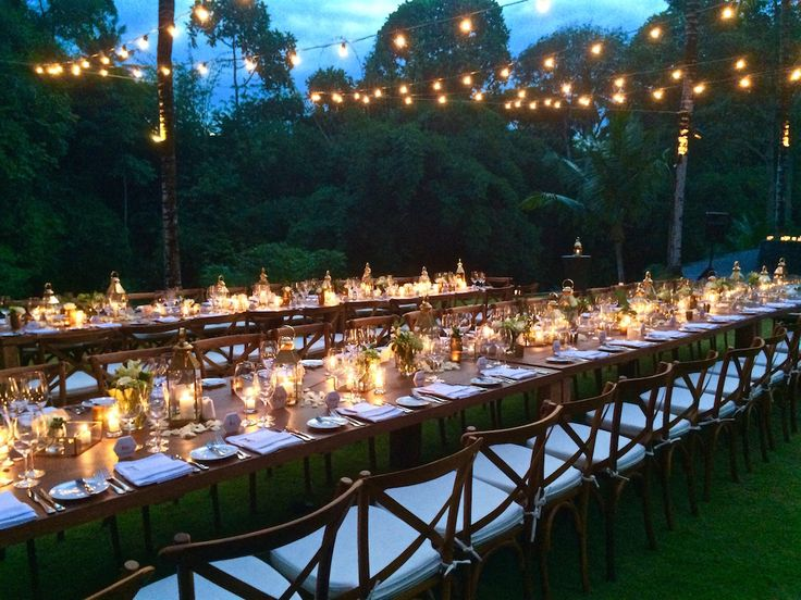 Wedding reception dining area | Cross back teak chairs, Teak dining table, Brass lanterns & boxes | w/ @baliultimate @balicatering @westsideentertainment @TheSanctuaryBali