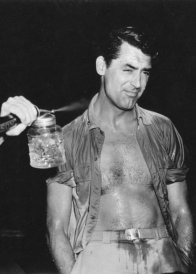 """archiesleach: """" Cary Grant gets hosed down for a scene in Destination Tokyo, 1943. """""""