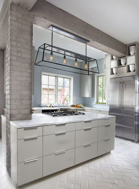 I do love this painted gray brick here around the arched doorway on the columns in the modern kitchen. So elegant and calming I think. Lots paint exposed brick white but I'm liking this gray.