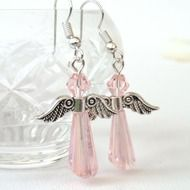 A pretty pair of angel earrings made with two pink crystals and silver coloured wings. The earrings hang from silver plated wires and have a drop of approximately 3 cm / 1 1/8 inches, as measured from the base of the earwires. These earrings would make...