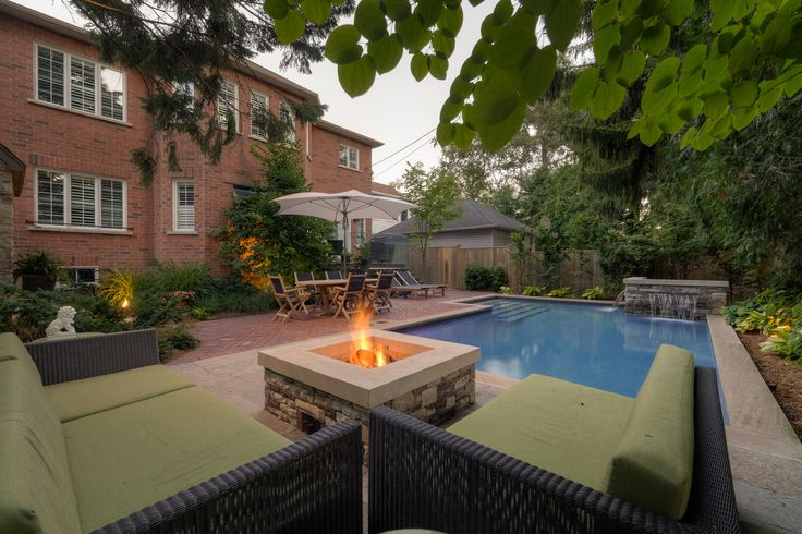 A stone fire pit serves as a great focus point for your backyard #Toronto #oasis