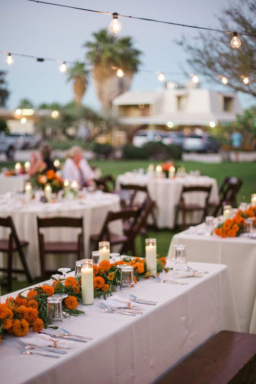 Retro Desert wedding in Joshua Tree at 29 Palms Inn. Marigold garland for long tables