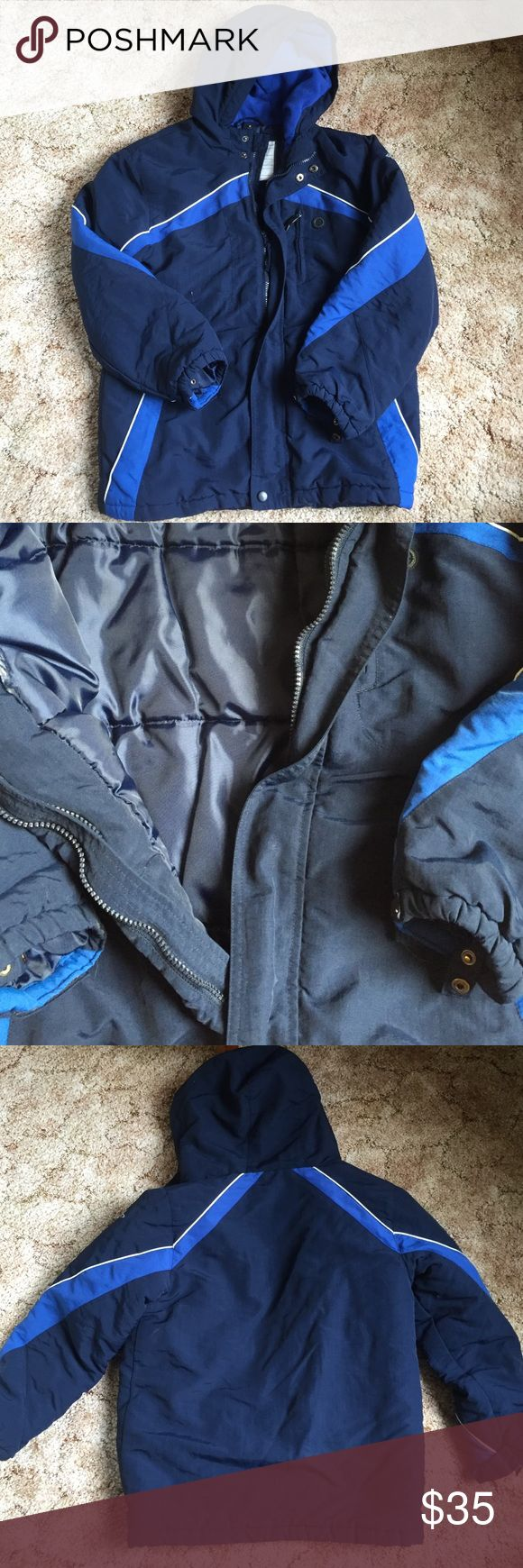 Boys Winter Coat This coat is perfect for the winter time. The outside is dark blue and light blue and comes with a hood. The inside is made with puffy material to keep you warm during the winter time. Jackets & Coats Puffers