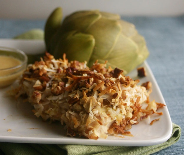 Coconut-crusted halibut looks fancy, but is so easy to make. Here served with steamed artichoke and hummus-sesame dipping sauce. From the book #fastmetabolismdiet for Phase 3.